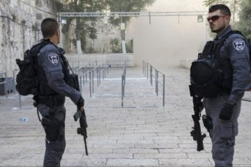 israeli police officers standing guard in Jerusalem