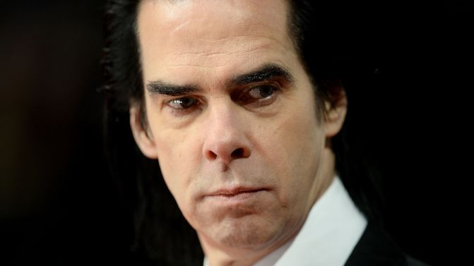 Close up of Nick Cave looking a bit menacing