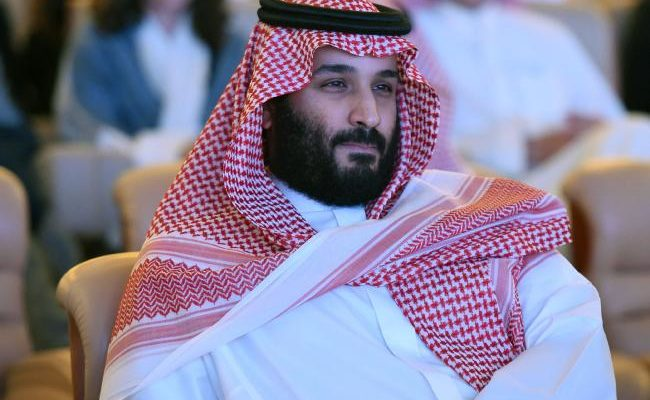 Saudi Crown Prince seated looking into the distance