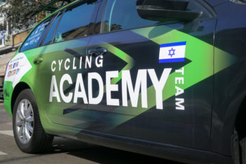 close up of car with the Israeli cycling academy's logo written on it