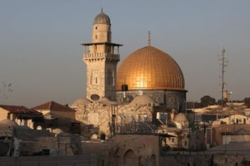 view of the dome of the rock with sun glinting off the dome