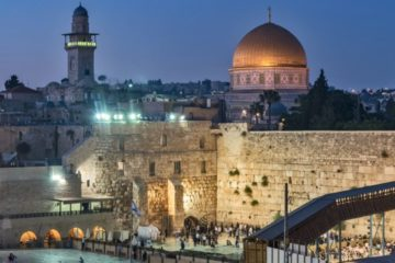 evening shot of kotel with dome of the rock in the background