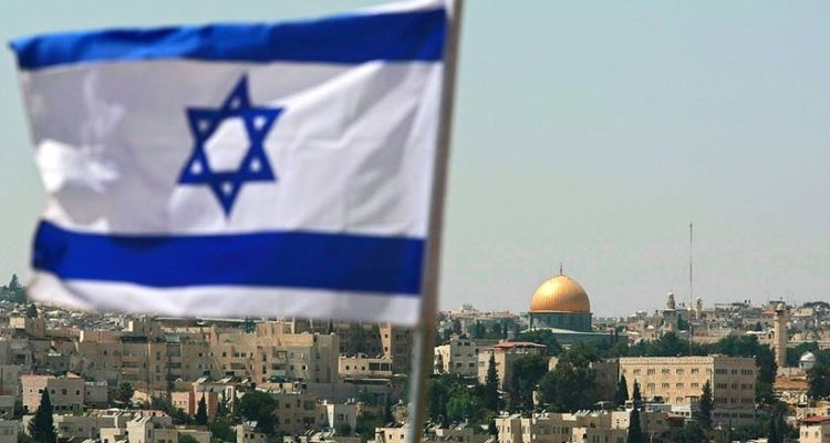 Jerusalem flag flying in foreground with dome of the rock in the background