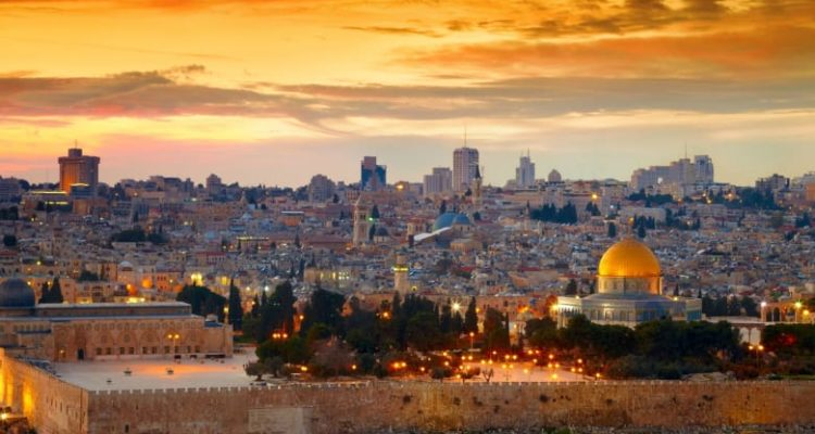 old city with beautiful sunset and sparkling lights