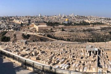 View of Jerusalem from the Mount of Olives with old city then new behind it
