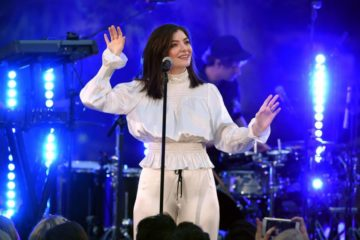 Lorde on stage, behind microphone