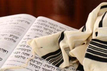 stock photo of prayer book and prayer shawl