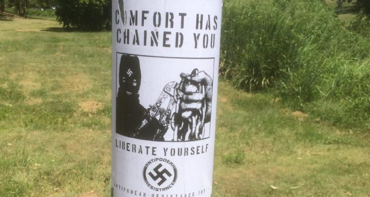 the poster wrapped around a pole