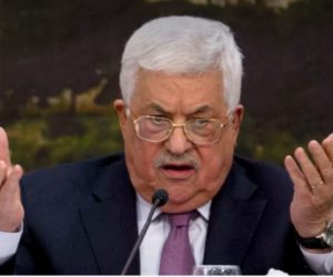 Abbas at the microphone, gesticulating