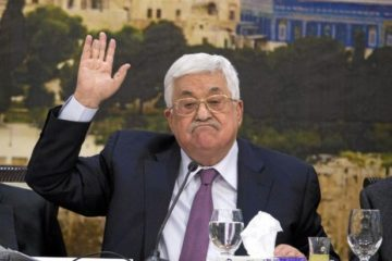 Abbas with hand in his air, during meeting
