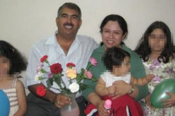 Hamed with his wife and children