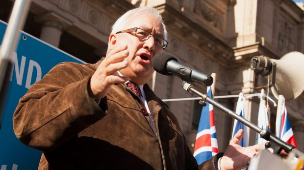 Danby at the microphone at a rally