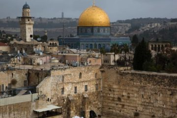 Dome of the Rock in background with western wall in foreground