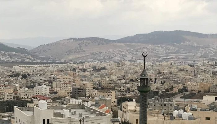 view of Baqa'a, with a minaret in the foreground